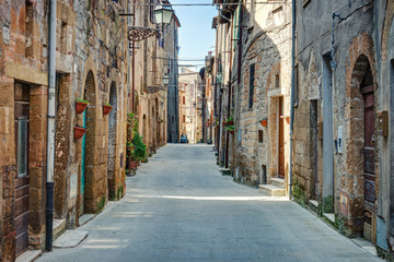 Fototapete - Alley in old town Tuscany Italy