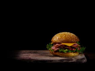 A beautiful sandwich on a board...dark and moody.