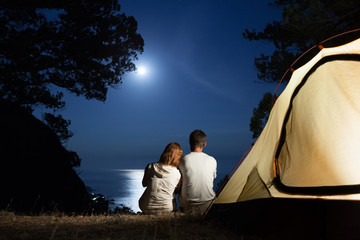 Silhouette of couple at moon night