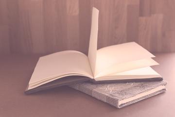 Open notebook on grunge background,vintage style.Open notebook o