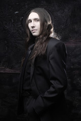 portrait of a fashionable male model with long hair