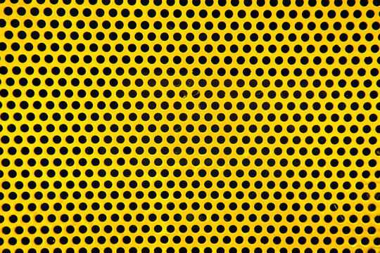 Holes in yellow Metal Plate