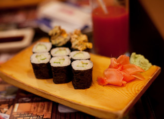 served maki rolls on wooden plate