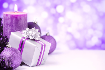 Purple Christmas scene with baubles, gift and candles