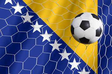Bosnia waving flag and soccer ball in goal net