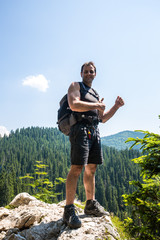 Male hiker standing on a very high cliff