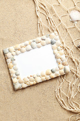 Frame of sea shells on beach sand