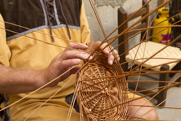 craftsman making wicker baskets traditionally