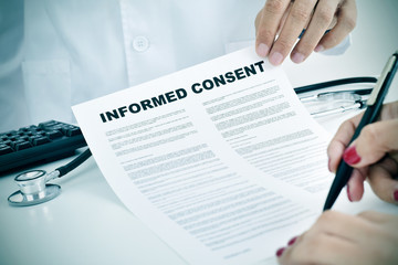 young woman signing an informed consent