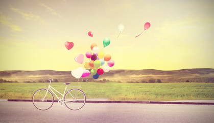 Wall Mural - bicycle vintage with heart balloon on beach blue sky concept of love in summer and wedding