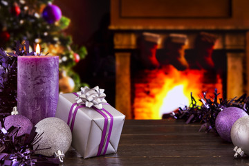 Christmas scene with a fireplace in the background.
