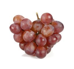 Bunch of red grapes isolated on white background.