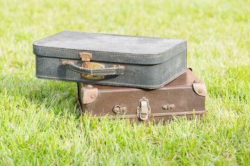 old suitcase on grass