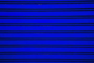 Dark blue steel roller shutter door background ( garage door wit
