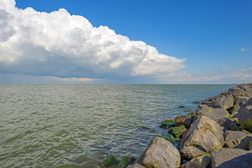 Deteriorating weather above a lake in summer