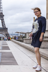 PARIS, FRANCE, on SEPTEMBER 1, 2015. The tourist is photographed near the Eiffel Tower