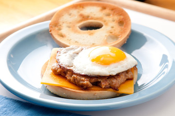 egg with sausage patty on bagel