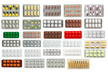 collection of pills in transparent blister packs isolated on whi