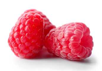 Red sweet raspberries isolated on white