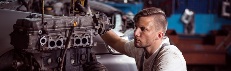Man in auto repair workshop