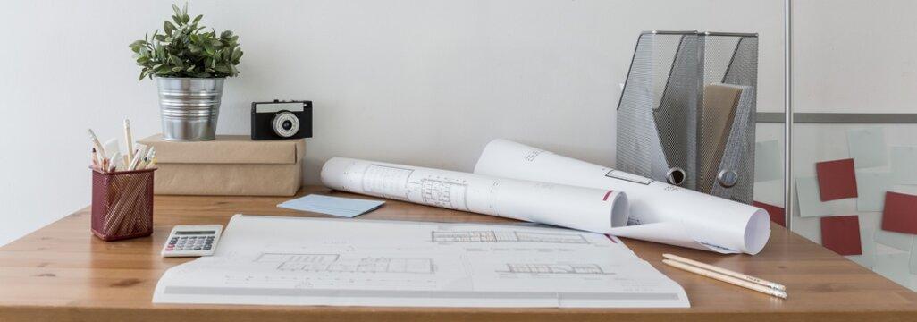 Blueprints on wooden desk