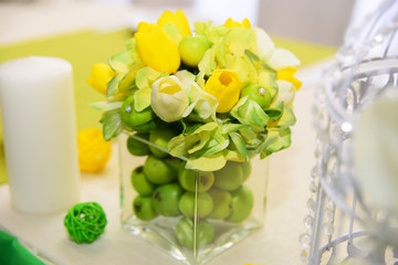 Wedding decorations. Making a table in green apple and lemon