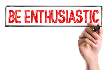 Hand with marker writing the word Be Enthusiastic