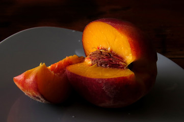 Juicy peach on black