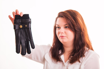 Woman holding black leather glove