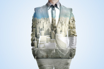 Double exposure of business man and city skyline