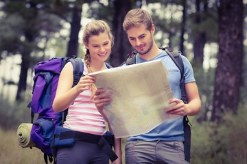 Young happy couple looking at a map