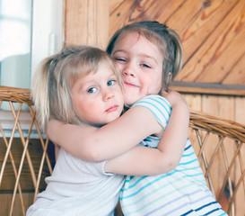 little sisters hugging
