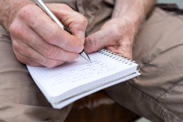 Man taking notes on a pocket book