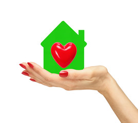 Female hand with small model of house with red heart isolated on