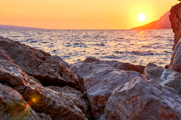 Photo sur Toile Canyon Rock island at golden sunset in Brela, Croatia