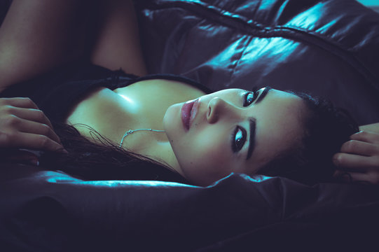 Sexy latina model lying in seductive position revealing some