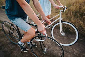 young couple on vintage bikes riding