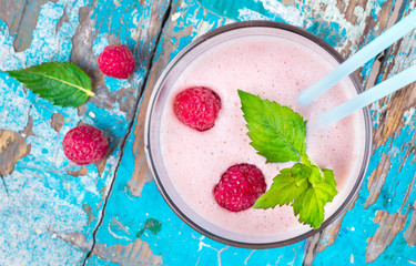 milkshake with fresh ripe raspberries
