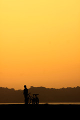 Silhouette of cyclist at sunset.