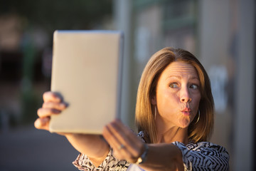 Lady Posing For Tablet