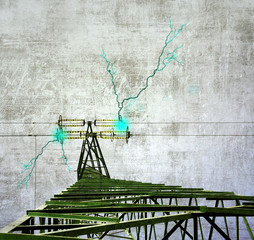 Grunge image of power pylon with electric shocks.