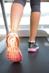 Highlighted ankle bone of woman on treadmill