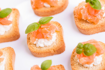 Canapes with smoked salmon and cottage cheese.