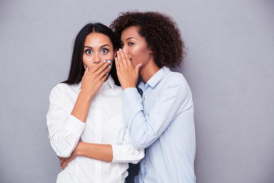 Portrait of a two girls gossip