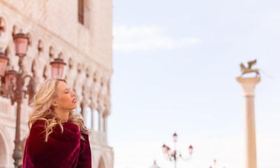 Portrait of woman in red cloak in Venice