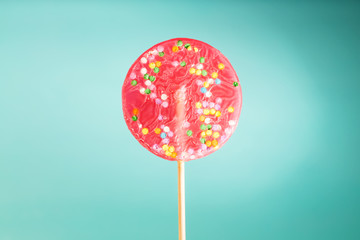 Giant lollipop on blue background