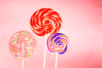 Giant spiral lollipops on a pink background
