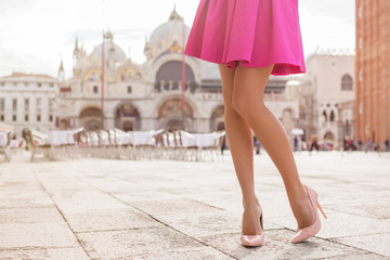 Elegant lady with beautiful legs in high heel shoes