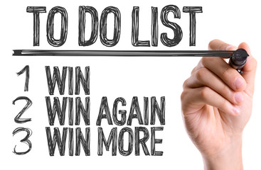 Hand with marker writing: To Do List Win/Win Again/Win More