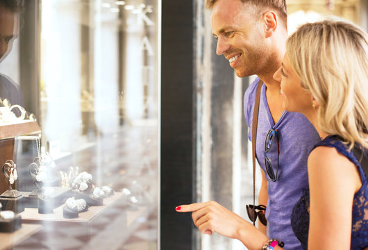 Couple looking at jewelry store window